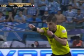 Riot police protect referee from Gremio players after VAR penalty decision in River Plate win